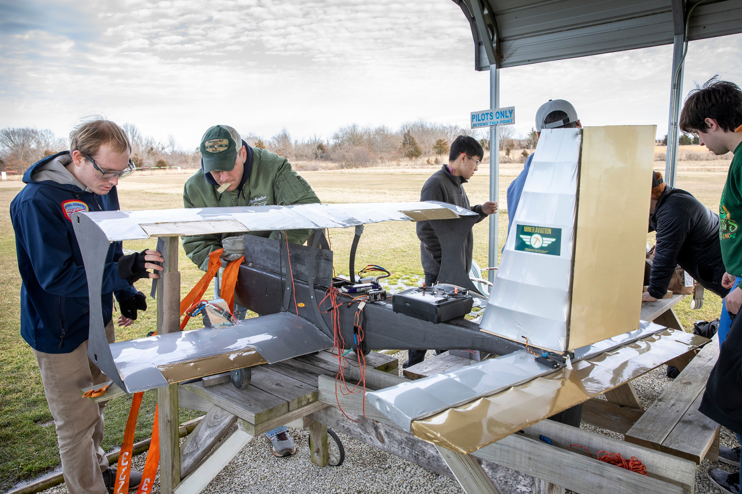 Photo Tom Wagner/Missouri S&T, Students of the Miner Aviation Design team prepare a prototype version of their 2020 aircraft at the Rolla RC airfield, Vichy, MO. The team is based out of the Student Design and Experimental Learning Center, SDELC, as Missouri S&T. ©2020 Tom Wagner/Missouri S&T. This image is copyrighted and all moral rights asserted by Missouri S&T Marketing and Communications Dept., Rolla, Missouri, USA