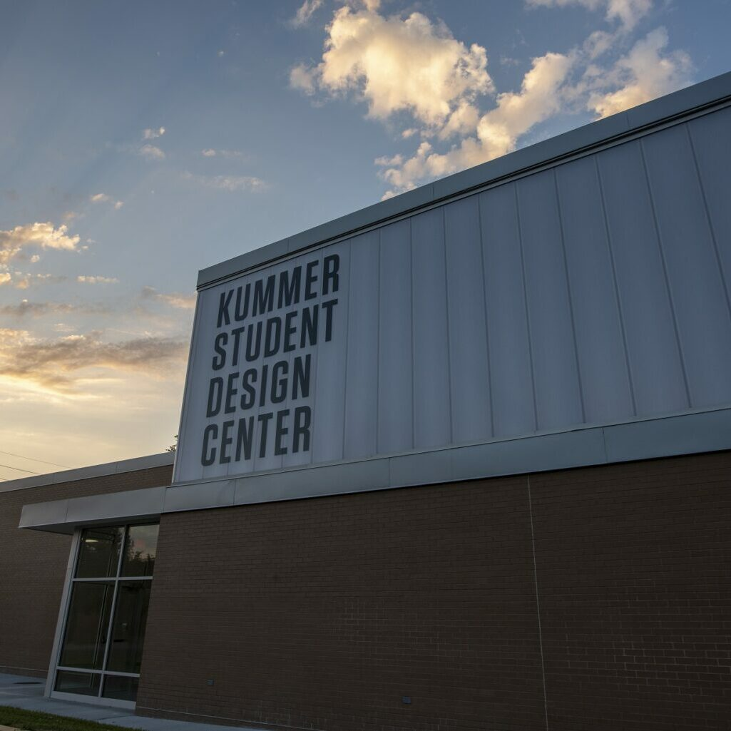 Photo ©2020 Tom Wagner/S&T Design Center, Missouri S&T Student Design Center, (SDELC), Exterior Architectural night photo of building extension with signage.